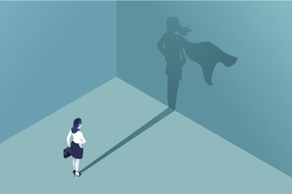 Business woman's shadow is superwoman