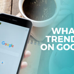 Phone screen with google and text 'what's trending on google'